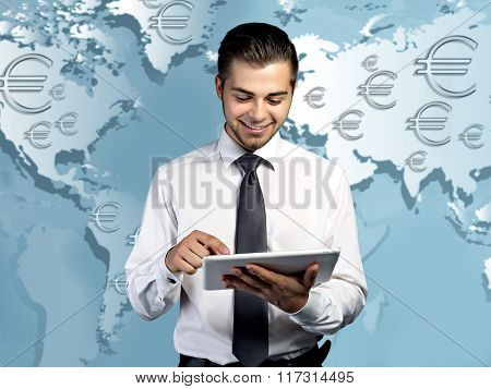 Business success strategy concept.Handsome businessman holding tablet on world map background