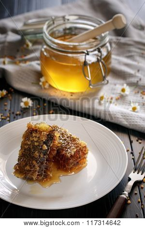 Fresh Honeycombs On Plate, Honey And Pollen On Background
