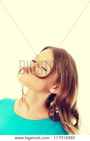 Happy young woman with hair moustache