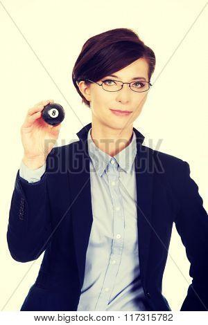 Businesswoman holding eight billiard ball.