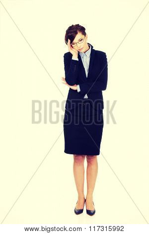 Worried businesswoman touching her head.