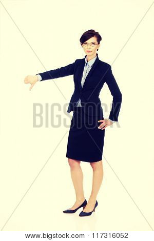 Business woman showing thumbs down.