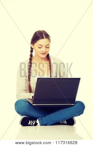 Woman student sitting with laptop.