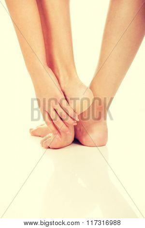 Woman touching her feet.