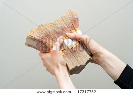 Hand with russian roubles bills  on white background