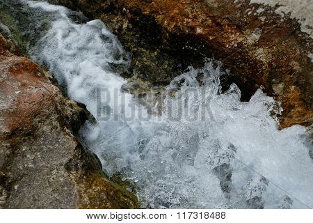 Water flowing from the stones