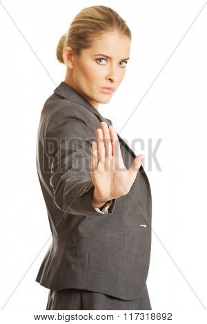 Woman making stop sign with her hand