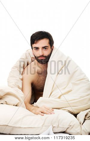 Man waking up in bed.