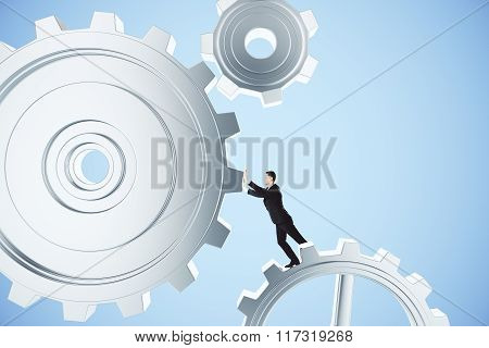 Business Concept With Man Pushes Gear