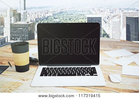 Open Laptop And Cup Of Coffee On A Wooden Table