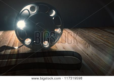 The Tape Of Film On The Wooden Table, Backlit
