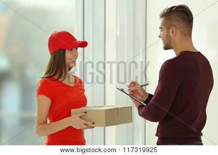 Young man receiving parcel
