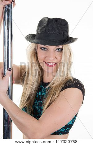 Professional Poledancer  Girl With  Black Hat Performs Tricks On A Pole.