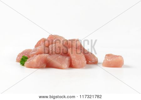 heap of diced turkey breasts on white background