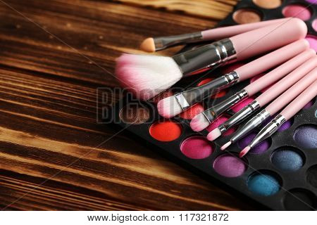 Makeup Brush Set With Palette On A Brown Wooden Table