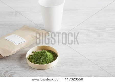 Top View Paper Bag, Glass And Matcha Tea On White Table