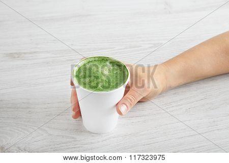 Woman Takes Away Matcha Latte