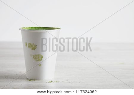 Matcha Tea Latte In Paper Glass With Fingerprints