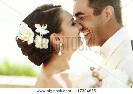 Happy Handsome Groom And beautiful Bride Hugging On Balcony At Sunset Closeup