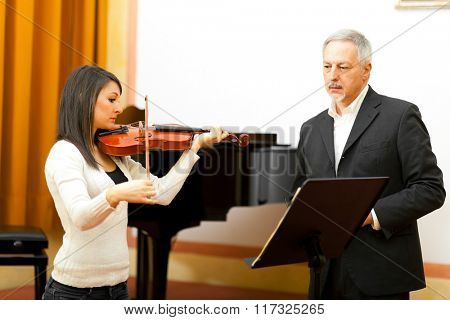 Female musician learning to play violin