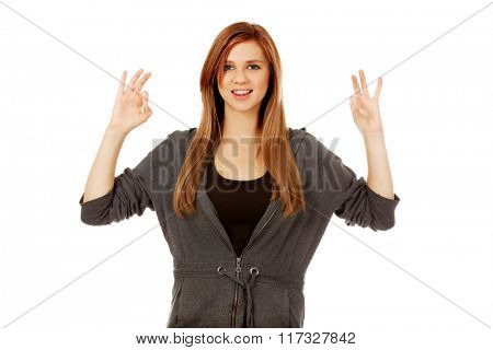 Teenage woman showing two OK signs