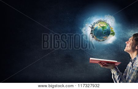Guy with red book in hand