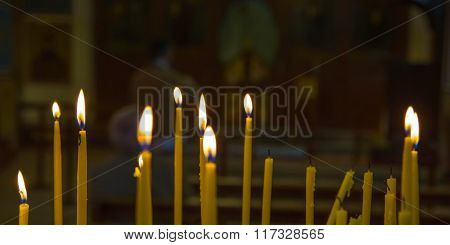 Lighted candles in church