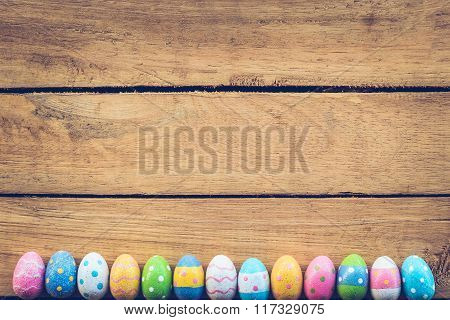 Easter Eggs On Wood Background With Vintage Tone.