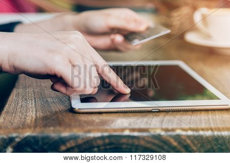 Hand Woman Pays By Credit Card For Online Purchase On A Tablet Computer.