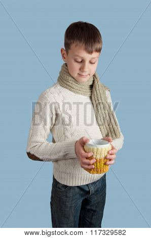 Cute boy with a white cup on blue background