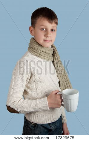 Cute boy with a cup on blue background
