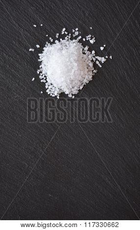 Coarse Salt On A Black Slate Table
