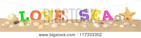 Love Sea Letters On A Beach Sand On A White