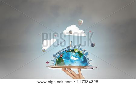 Earth planet on metal tray
