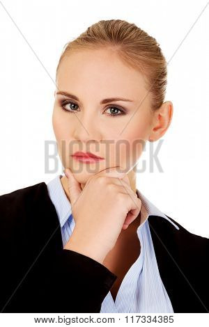 Young serious thoughtful business woman