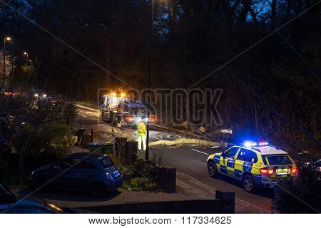 SOUTHAMPTON, ENGLAND - February 8 2015: Emergency services recover vehicle, that has been hit by a falling tree during Storm Imogen, on the edge of The Common, Southampton, UK.