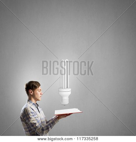Man reading red book