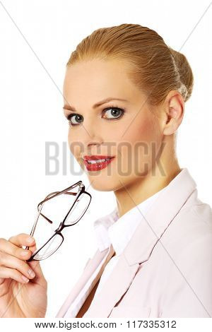 Young smile business woman holding glasses