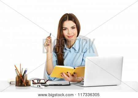A beautiful woman working at the office, isolated on white