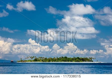 Idyllic tropical island and turquoise ocean water