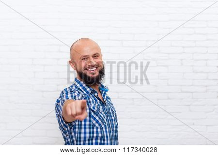 Casual Bearded Man Smiling Point Fingers At You