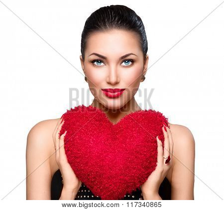Sexy model Woman portrait. Gorgeous young brunette woman with heart shaped red pillow. Perfect make up. Valentine' Day brunette lady headshot. Valentine, love