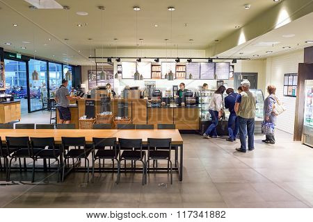 SAINT PETERSBURG, RUSSIA - JULY 08, 2015: interior of Starbucks cafe. Starbucks Corporation is an American global coffee company and coffeehouse chain based in Seattle, Washington