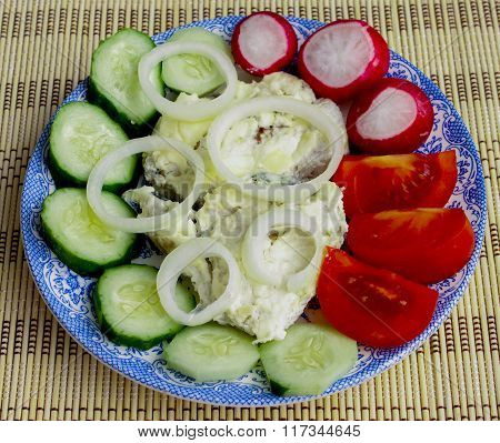 Salad From Vegetables And Fried Fish