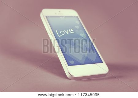 Modern touchscreen mobile phone with romantic screensaver