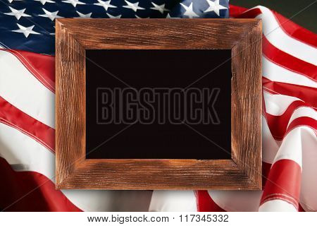 Wooden frame on American flag background