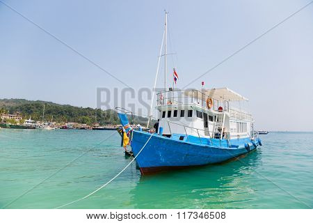 Cruise tourist boat at anchorage off the island of Phi Phi Doh. Andaman Sea, Thailand