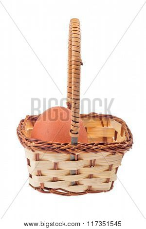 brown egg in basket isolated on white background