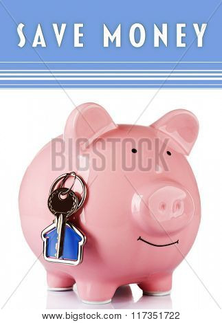 Piggy bank style money box with key isolated on a white