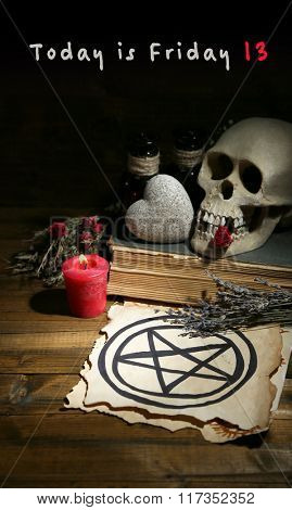 Composition with skull, dried herbs, candle and text Today is Friday 13 on dark background